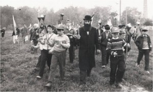 Dr. Arkady Aharon Shmist leading an annual march to the mass grave of the 12,000 Jews killed in Dnepropetrovsk in 1941. (Photo courtesy of the Shmist family.)