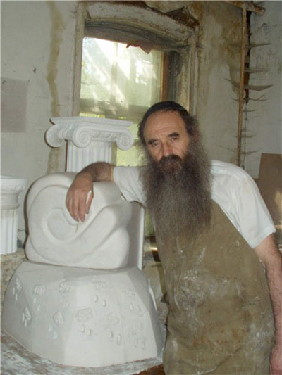 Shmist in his workshop making a memorial gravestone in 1992. (Photo courtesy of the Shmist family.)