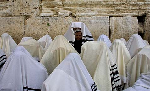 The Priestly blessing at the Western Wall, but no women priests - yet.