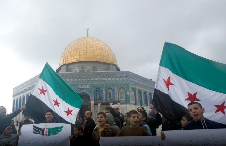 Arabs shout slogans against the Assad regime in demonstration at Al Aqsa mosque in Jerusalem earlier this year