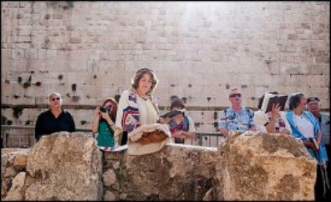 The WOW group pray at the Kotel, but Jordan objects.