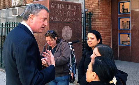 Mayoral candidate Bill de Blasio chatting with public school students.