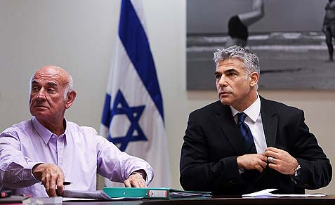 Finance minister and leader of the Yesh Atid party Yair Lapid (R) and Yesh Atid MK Yaakov Perry are insisting on criminal and economic sanctions against Haredim over the draft.
