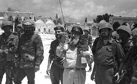 Rabbi Shlomo Goren blowing the Shofar near the Western Wall in June 1967.