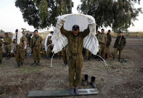 Israeli soldiers of the Golani Brigade pray close to the cease-fire line between Israel and Syria on the Golan Heights.
