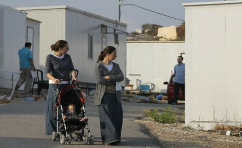 Women and baby at Givat Asaf. A US Embassy officials attended a hearing on a Peace Now petition to story the community
