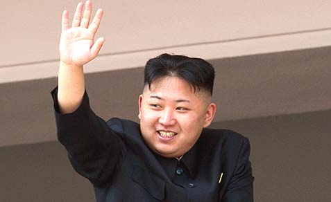 Young Kim Jong-Un waving to an adoring crowd.