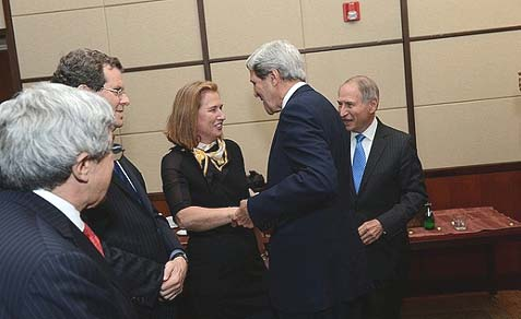 Secretary of State John Kerry speaks with Israeli Justice Minister Tzipi Livni and American Jewish Committee officials at the American Jewish Committee Global Forum in Washington, DC on June 3, 2013.