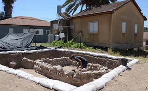 The excavation of an early Canaanite home is taking place right next door to the moshav homes.