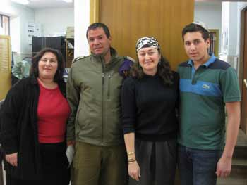 Shira Gilor, project manager for A Package From Home, a lone solider named Chosem, Helen Fuchs, Elliot Fuchs.