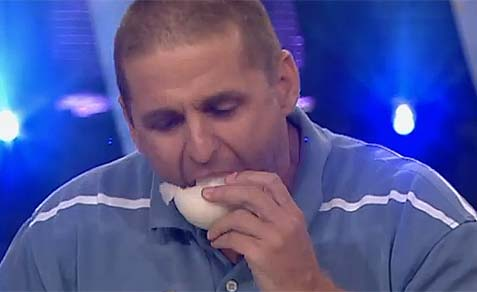 Man Eats Raw Onion