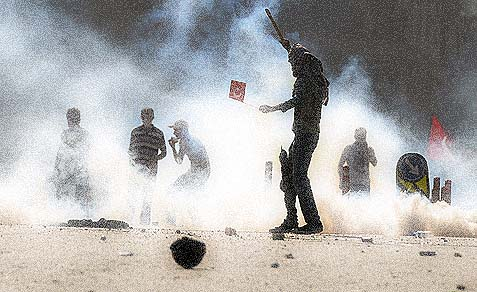 Turkish protesters clash with riot police at Taksim Square in Istanbul.