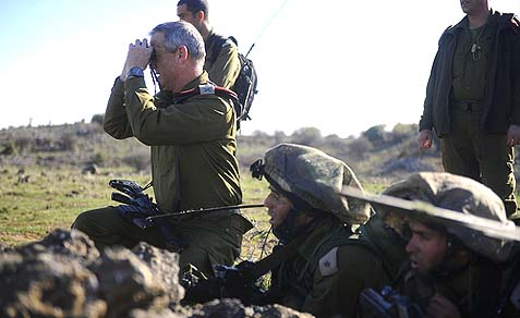 IDF Chief of General Staff Benny Gantz observes an exercise in the Golan Heights, near the border with Syria, in November 2011.