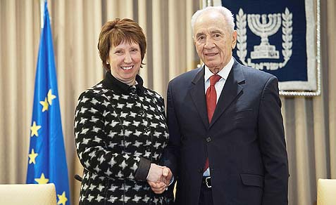 "Two enemies of Jewish life beyond the ""green line,"" Israeli President Shimon Peres and EU Foreign Policy Chief Catherine Ashton, shaking hands. The EU, in collaboration with the likes of Peres, have come up with an ingeniously evil plan to divide the Jews of Israel."
