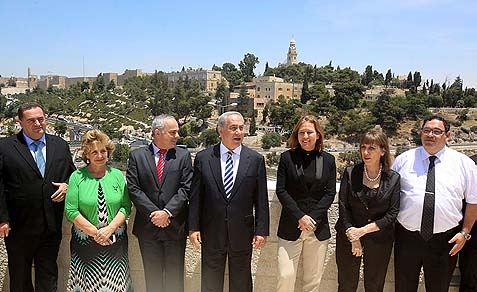 Netanyahu's coalition government posed in front of the old city of Jerusalem on Sunday, on the eve of negotiations with the Palestinians over whether or not it stays in Israel. Minister of Transportation Yisrael Katz, (l), Minister of Immigration Sofa landver (2L), Minister of Strategic Affairs and International Relations Yuval Steinitz, Israeli Prime Minister Benjamin Netanyahu (C), Minister of Justice Tzipi Livni (3R), Minister of Sports and Culture Limor Livnat and Minister of Education Shay Piron (R)