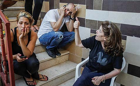 Family and friends of the murdered father and daughter Natan and Yamit Journo gather at the family house in Beit Shemesh.