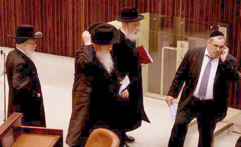 Haredi MKs in the Knesset on Monday, when the 'Equal Military Burden' law was passed on first reading