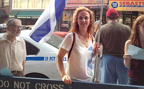 Ronit Jacobs of New Jersey was one of dozens who showed up outside the 92nd Street Y Thursday evening, July 11, to protest the Y's use of Jewish communal dollars to promote anti-Israel speakers.