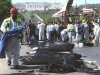 Body bags fill the streets near Gilo, Jerusalem after a Palestinian suicide bomber exploded a public bus on June 18, 2002.