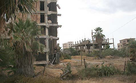 The crumbling buildings of the Varosha district of Famagusta, Cyprus, photographed in 2009. The area lies within Turkish-controlled northern Cyprus. The inhabitants fled during the 1974 Turkish invasion and the district has been abandoned since then. (Source: WikiMedia Commons)