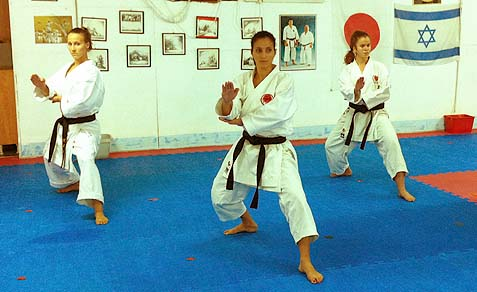 Loris Afara (C.) with fellow Karate practitioners.