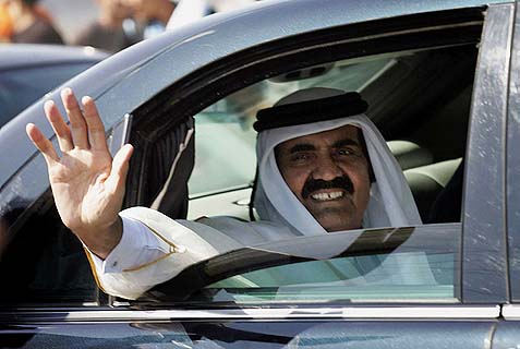 Qatari Emir Sheikh Hamad bin Khalifa al-Thani waves to the crowds during a brief visit to Gaza.