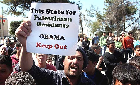 Palestinian demonstrators protest the Obama visit to Ramallah, March 21, 2013.