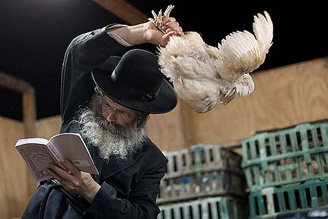 The rite consists of taking a chicken and waving it over one's head three times while reciting the appropriate text.