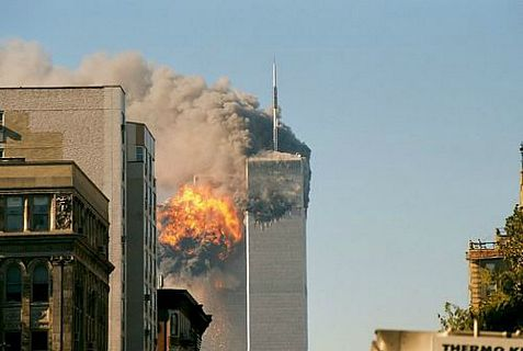 A Saudi paper has accused the U.S. of using global terrorism to promote its own agenda while Middle East jihadis praised the September 11 terrorist attack  online on its 12th anniversary
