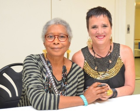 Author Alice Walker, an anti-Israel activist, and playwright Eve Ensler clasp hands at the 92nd Street Y in New York City on May 30, when they appeared together in dialogue.