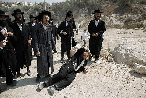 Haredi extremists shout at a demonstration in Beit-Shemesh in August against construction at a site allegedly containing Jewish graves