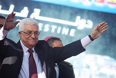 "Chairman Mahmoud Abbas waving to thousands of Palestinians celebrating the UN upgrading the PA status to ""non-member state"" in 2012."