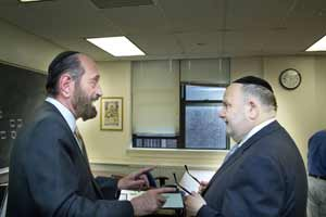 Cantor Joseph Malovany (left) provides instruction to Judge Martin Schulman. (Photo by David Khabinsky)