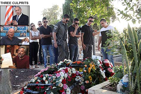 Mourners at the graveside of Tomer Hazan in the city of Holon, Israel, September 22, 2013. Hazan was abducted by an Arab seeking the release of his jailed brother, relying on Israel's long established policy of negotiating with terrorists.