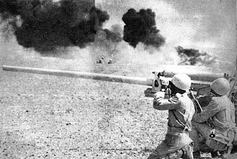 Egyptian artillery conduct a barrage during the Yom Kippur War.