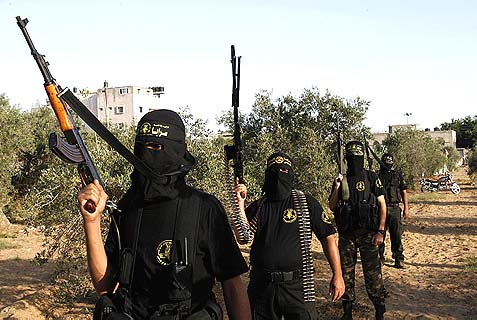 "Masked recruits of the Islamic Jihad military wing ""Saraya Al-Quds"" or ""Jerusalem Brigades"" strutting their stuff."