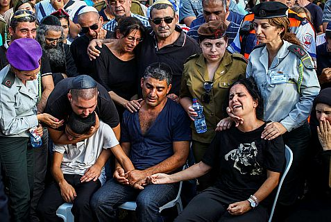 The family of Israeli soldier Staff Sergeant Gal Kobi, 20, seen during his funeral in the military cemetery in Haifa on Monday, after he was shot in the neck near a checkpoint in Hevron.