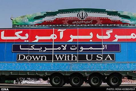 "Banner at Tehran military parade, Sept. 23, 2013. Although the English statement is relatively mild, in Persian and Arabic it says ""Death to America."""