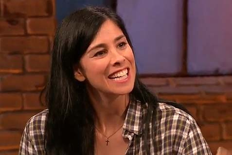 "Sarah Silverman with the offending cross on the W. Kamau Bell ""Totally Biased"" show on FXX."