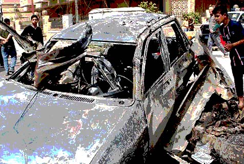Iraqi Shiites examining an al-Qaeda exploded car in a civilian center. The return of the terrorist organization to Iraq with such vigor should be a bonanza, not a source of anxiety, to U.S. policy in the region.