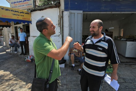 Aryeh King (l) talking with a local Arab resident in Jerusalem, in 2009