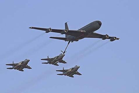 An IAF BOEING 707 fueling three F-15 aircraft in flight, facilitating long-range missions, such as those being planned against Iranian nuclear sites.