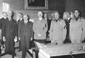 "Most references to the Munich moment usually show PM Neville Chamberlain waving a piece of paper and announcing ""peace in our time."" But the really scary Munich moment took place hours earlier, when these dubious characters signed on to the deal. It was about the West's willingness to knowingly embrace the lies of the thugs it was dealing with, leaving Czechoslovakia to pick up the tab. From left to right, Chamberlain, French PM Daladier, Hitler, Mussolini and Italian Foreign Minister Count."