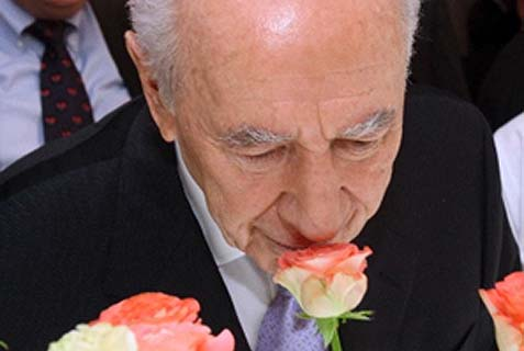 "Israel's President Peres, ""Mr. Optimism,"" can smell flowers even where are none to found."