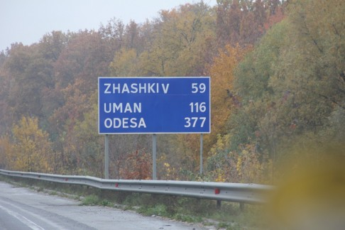On the road to Uman from Kiev there are a few signs in English. My trip to Uman, Medzhybizh and Berdichev was 800 Kilometers in 13 hours. I had a Ukrainian gentile cab driver who was very knowledgeable and knew his way to Jewish sites - but even then they were hard to find and we had to backtrack a few times.