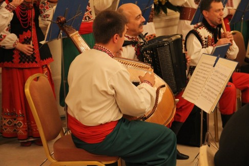 "At the conference plenum, we enjoyed the sounds of a large ensemble band, wearing traditional Ukrainian clothing, as they played a mix of traditional and Jewish music. The is a picture of the Bandura player -  Ukraine's national instrument. When they played ""If I were a rich man"" from Fiddler on the Roof, it all came together. The musical Fiddler on the Roof, based on Sholem Aleichem's stories about Tevye the Dairyman, was the first commercially successful English-language stage production about Jewish life in Eastern Europe.  Sholem Aleichem (1859 - 1916) was a leading Yiddish author and playwright from Ukraine and the Tevye tales still reflect a lot about the ambivalence and duality of Jewish/Ukrainian life. The Fiddler song that really came to my mind that evening was ""Lechaim - To Life!"" in the great bar scene where the Jews and gentiles dance together: ""Za Vashe Zdorovie - Heaven bless you both Na Zdrovie - To your health and may we live together in peace!"""