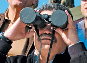 Some images you just don't live down. This is HaTnua no. 2 man Amir Peretz in his capacity as defense minister, looking at things through a capped binoculars.