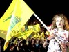 A little girl holds a Hezbollah flag during a rally in Beirut, Lebanon.