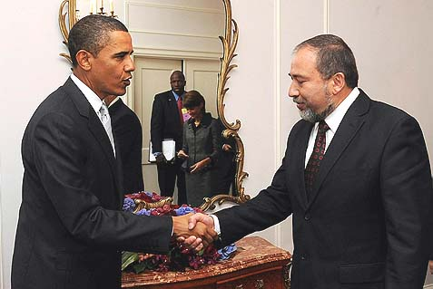 "President Obama shaking hands with Israeli foreign minister Avigdor Lieberman. The latter said this morning that ""when you see the smiles on the faces of the Iranians, it's clear that victory is theirs."
