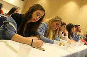 Students from the David Posnack Hebrew Day School in Florida take notes during JUMP Leadership conference session.